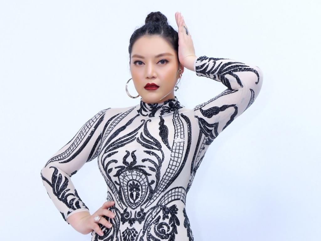 Xuân Nghi tiết lộ Quang Dũng là ca sĩ nổi tiếng đầu tiên mà cô được hát song ca